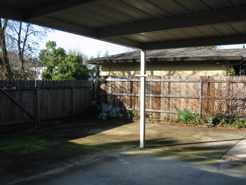 The large yard is covered in concrete