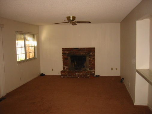 A boring family room and fireplace